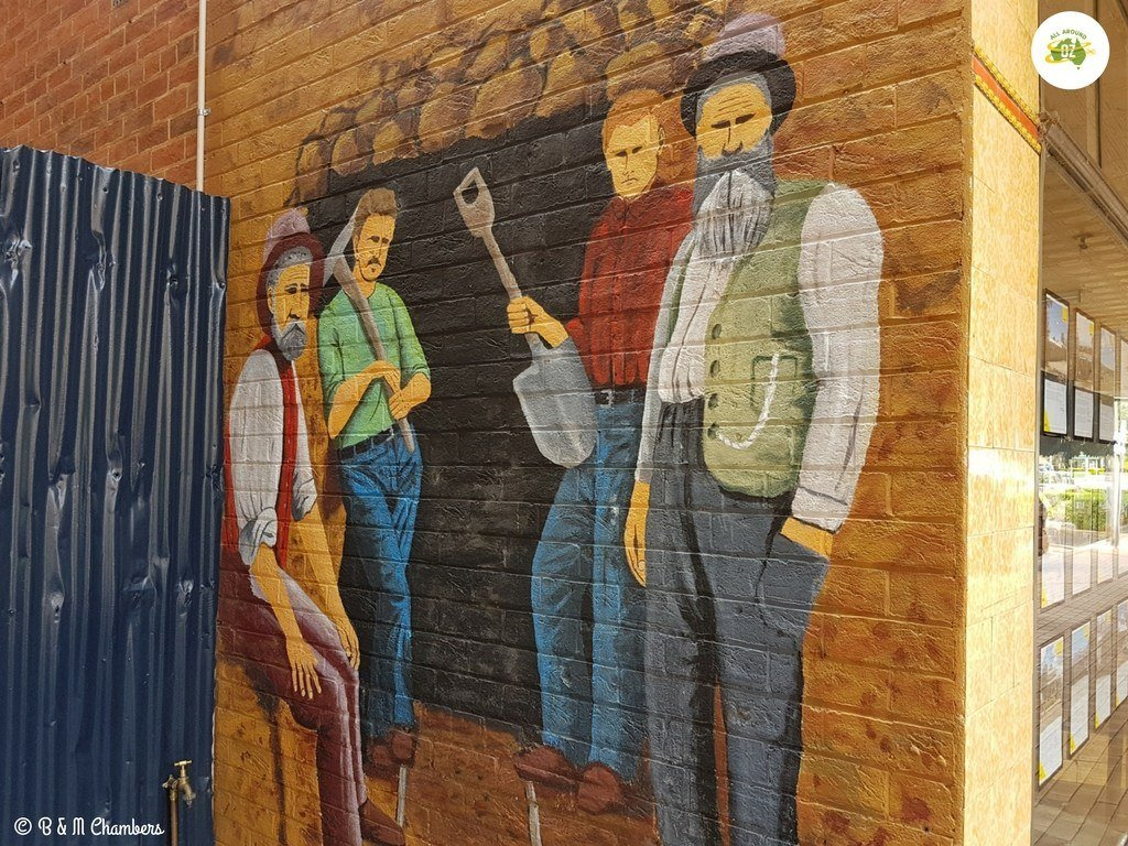 A mural at a wall in Bingara depicting life years ago.
